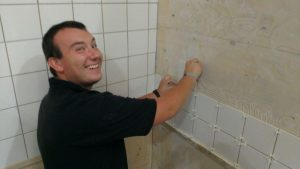 A student a Chameleon School of Construction during his Wall and Floor Tiling training course.